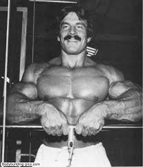 Mike Mentzer performing cable pulley upward lifts