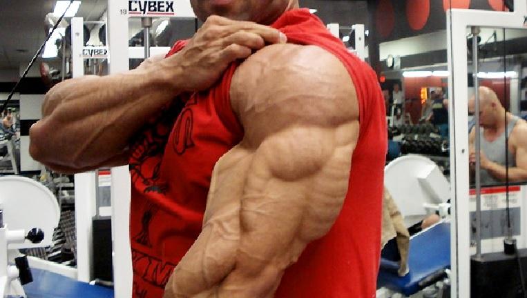 Bodybuilder FLexing Triceps