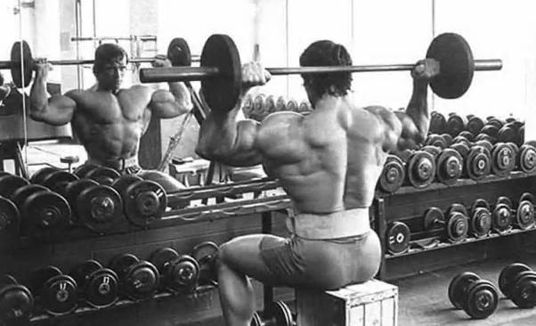 Arnold doing rear delt press
