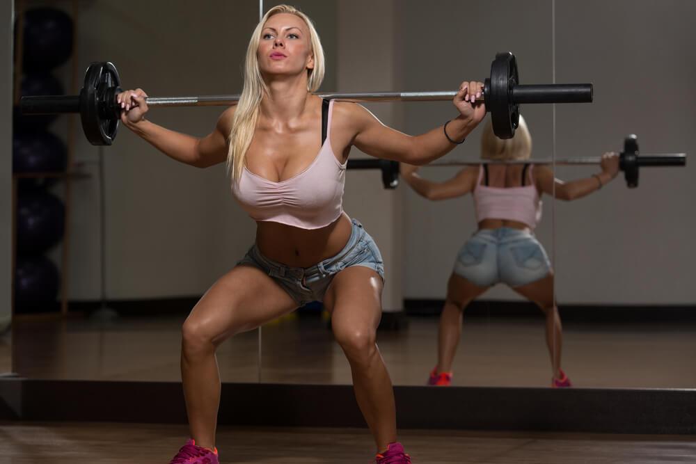 Woman Doing Barbell Squat