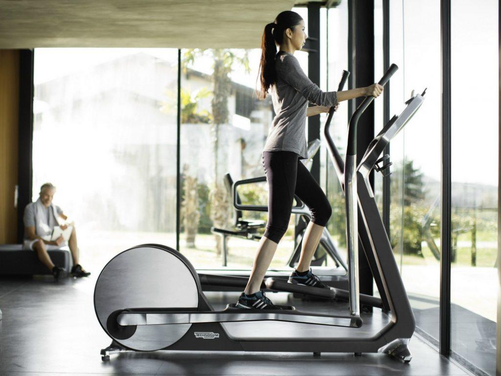 Woman riding elliptical
