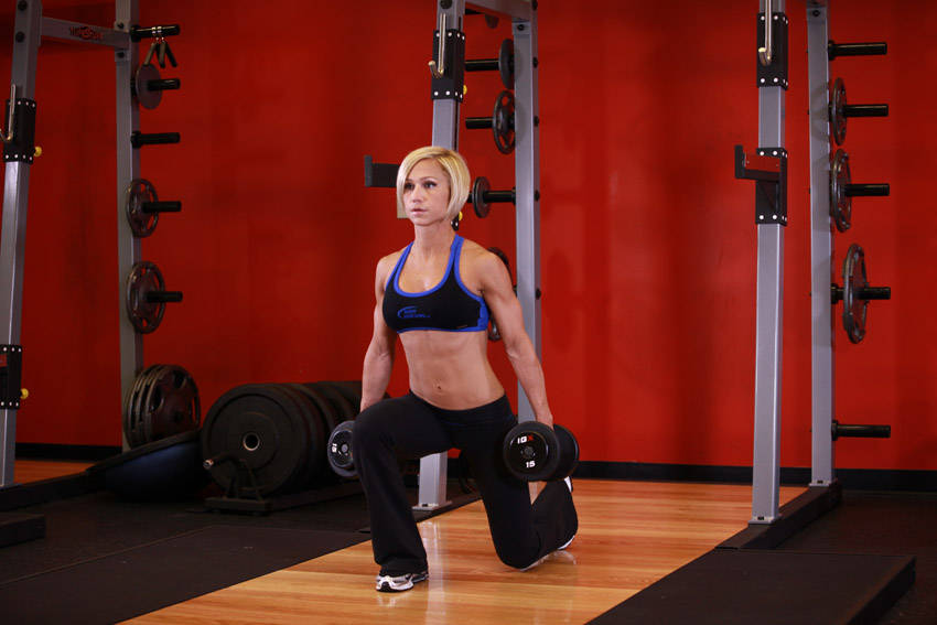 Woman performing Dumbbell lunges