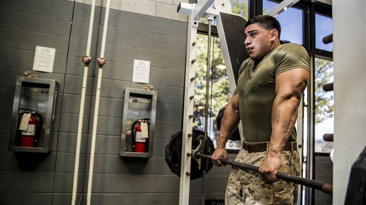 Marine Doing Shoulder Shrugs on Smyth Machine