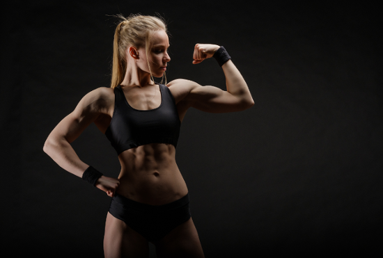 Blonde Fitness Model Flexing Bicep