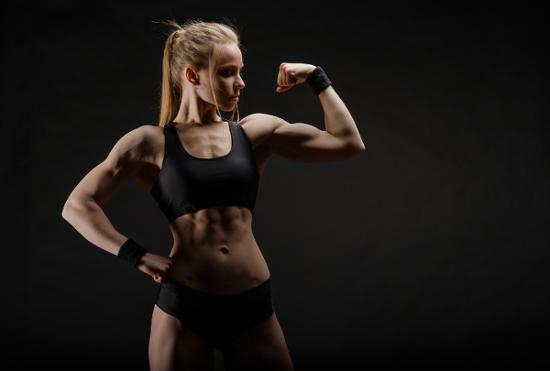 Blonde Woman Flexing biceps