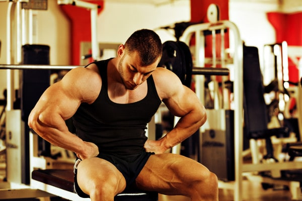Bodybuilder Sitting on Bench