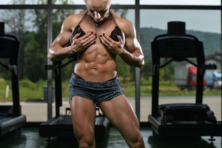 Female Bodybuilder Showing Off Abs