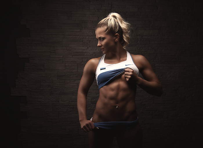 Female Bodybuilder Posing Showing Off Abs