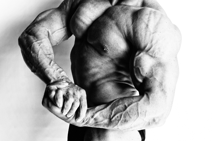 9 Benefits of Getting Shredded - Ripped Bodybuilder Posing