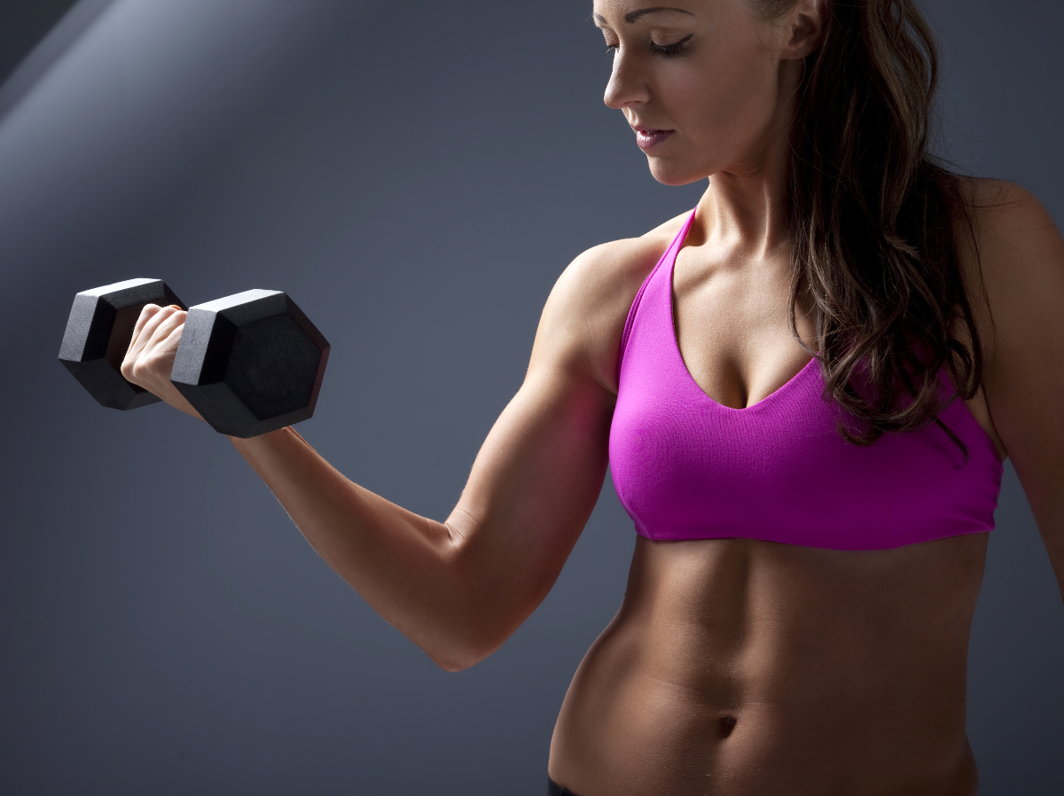 Fitness Model Holding Curling Dumbbell
