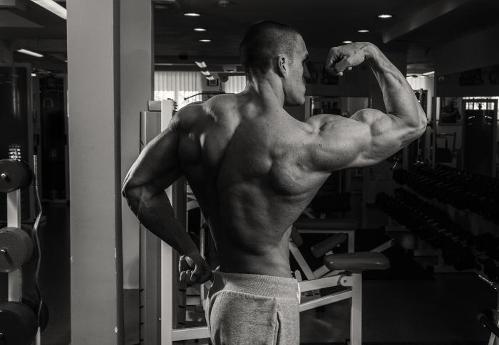 Bodybuilder Flexing - Best Three Cutting Steroids for Bodybuilding