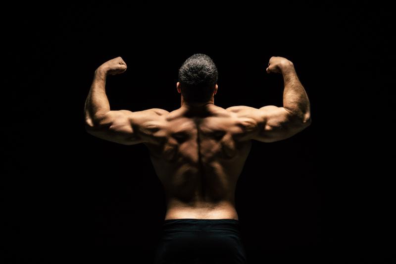 Best Back Exercises = Bodybuilder posing flexing back muscles