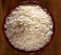 Uncooked white rice in bowl
