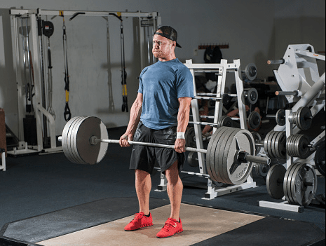 Man Doing Deadlifts with 5 plates
