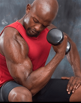 Middle aged man performing sitting dumbbell bicep curls