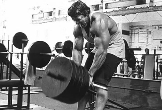 Arnold Schwarzenegger Performing Old School T-Bar Rows