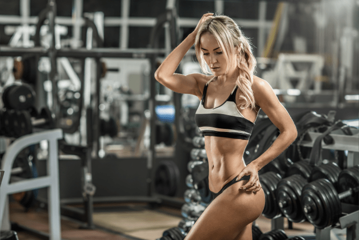 Female Fitness Model Doing Lunges