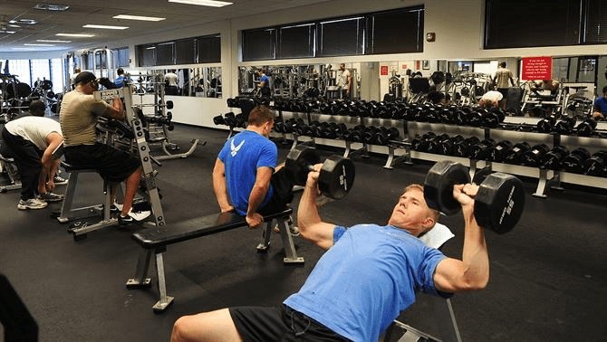Man Bench Pressing dumbbells