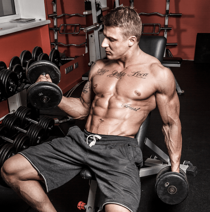 Male Bodybuilder Doing dumbbell Curls