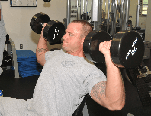 Myths About Strength Training in Your 40's - Man Shoulder Pressing dumbbells
