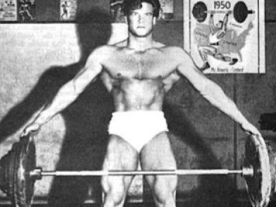 Steve Reeves performing pinch grip dead lift