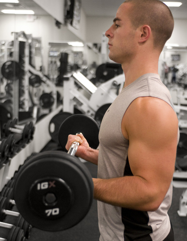 Young Man Doing Barbell Curls