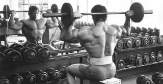 Arnold doing rear delt press
